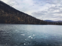 Bear Mountain barely iced over lake  x