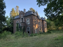 Beautiful abandoned chateau with the sunset Rochefort Belgium
