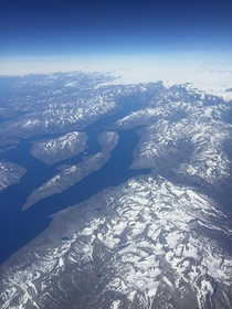 Beautiful Greenland archipelago taken from the window seat of a plane