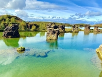 Beautiful rock formations at Hofdi Nature Reserve Iceland We almost skipped this stop since there were only - cars parked out there Turned out to be an amazing place with crystal clear water and vistas akin to a painting