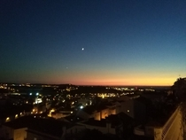 Beautiful sunset with the moon and the stars appearing in the sky