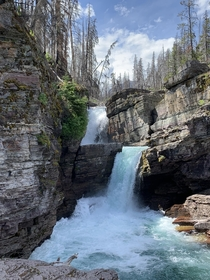 Beautiful waterfall at Glacier National Park Montana