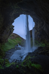 Behind a waterfall in Iceland during dusk at  am  IG holysht