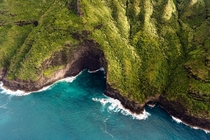 Below a rumpled blanket of green a dramatic Kauai coastline