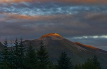 Ben Nevis from Fort William - Suns rays just catching the top of the mountain Taken by my daughter Caitie Sankey  x