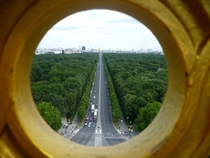 Berlin Germany through a golden hole in the Victory Column