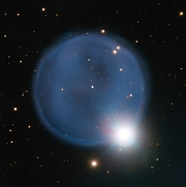 Better put a ring on it Abell  Created when an aging star blew off its outer layers this beautiful blue bubble is aligned with a foreground star and bears an uncanny resemblance to a diamond engagement ring This cosmic gem is unusually symmetric appearing