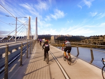 Bicyclists on the new Tilikum Crossing transit bridge Portland Oregon