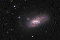 Big beautiful spiral galaxy M lies a mere  million light-years away About  thousand light-years across the gorgeous island universe is well known to astronomers as a member of the Leo Triplet of galaxies