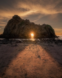 Big Sur California on one of the few nights every year the sun sets in Keyhole Arch Insanity