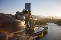 Bilbao Spain Where giant spiders walk the banks of the Nervin river catching boats next to the Guggenheim Museum