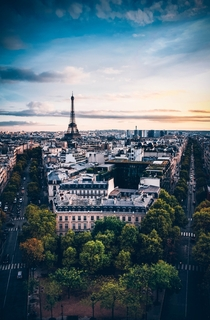 birds-eye view photography of Eiffel Tower under cloudy sky Paris France