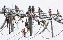 Birds on a wire eighteen workers repair an electric transformation substation in Xuzhou China August