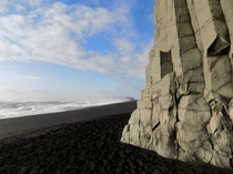 Black sand basalt columns and the Atlantic Ocean at Reynisfjara beach Iceland
