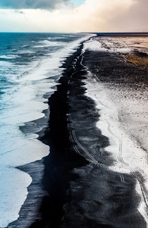 Black Sand Beach after snowfall Iceland