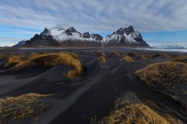 Black sand dunes in front of the dramatic Vesturhorn mountain in southeast Iceland