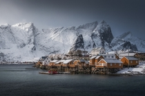 Black storm clouds wind and snow enshrouded the islands around the little village of Sakrisy Norway by photographer Jennifer Frickell