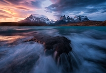 Blazing lenticularis clouds during a stormy sunset at Torres del Paine Chile