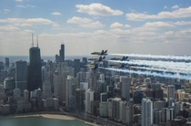 Blue Angels honored frontline COVID- first responders and essential workers with formation flight over Chicago on May