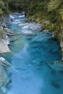 Blue creek at Mount Aspiring National Park in New Zealand