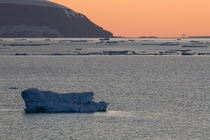 Blue ice in the golden hour  approaching midnight Antarctic Peninsula edge of Weddell Sea in foreground
