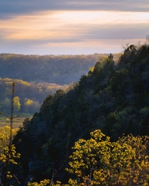 Bluffs over the Meramec River briefly illuminated by the setting sun Ozarks  x