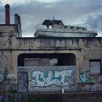 Boat on the roof of an abandoned factory in Matosinhos Portugal