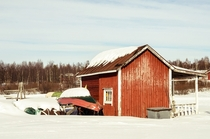 Boathouse by the frozen lake Muonio Finish Lapland