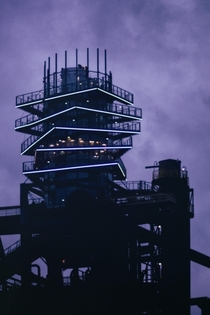 Bolt Tower in Ostrava Glass structure is built on top of blast furnace at the former mining complex