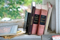 Books On An Abandoned Porch -