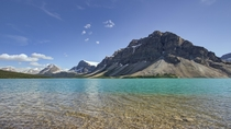 Bow Lake in Alberta where the waters are somehow both crystal clear and neon blue