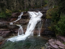 Breathtakingly beautiful waterfall Glacier national park Montana OC X