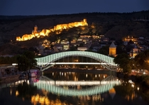 Bridge of Peace a bow-shaped pedestrian bridge a steal and glass construction illuminated with numerous LEDs over the Kura River in downtown Tbilisi capital of Georgia