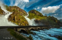 Bridge over waterfall in Ltefossen Odda Norway  by Tore H