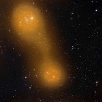 Bridging Cities of Galaxies Abell  lower center and Abell  top left are about a billion light-years from Earth and the gas bridge extends approximately  million light-years between them
