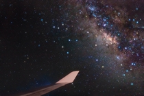 Bright stars of Sagittarius and the center of our Milky Way Galaxy lie just off the wing of a Boeing