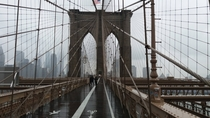 Brooklyn Bridge heading toward Manhattan on a chilly and rainy day in October  INY