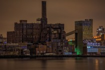Brooklyns abandoned Domino Sugar Factory at night shot from across the East River