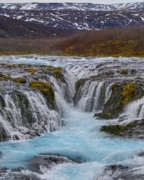 Bruarfoss Waterfall Iceland - Glacier water flowing through lava rock