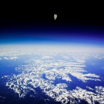 Bruce McCandless on the first untethered space walk in  Can anyone confirm if this is real or not In the more famous version there are no mountains visible but he appears to be in the exact same position here