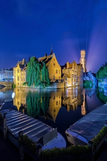 Bruges at night reflected in the canals