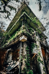 Building being digested by nature in Japan