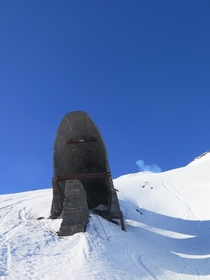 Burned-out skilift on the side of volcano destroyed in  eruption in Pucn Chile   x