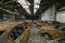 BURNOUT - Hundreds of burnt out cars line this dealership which was destroyed in an arson attack