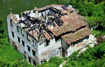 Burnt out building on the river in Pamplona Spain  OC
