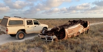 Burnt out old car destroyed in a roll over next to my ute our on a mud flat