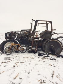 Burnt up tractor in an Iowa field