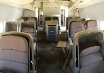 Business Class Cabin of a Retired  Left Abandoned in the Desert