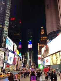 Busy Times Square NYC at Midnight