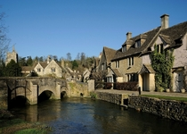 Bybrook River and Village near Castle Combe Wiltshire UK